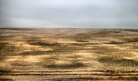 blown away: Anthropogenic landscape. Disturbed agricultural lands ( soil erosion) after black blizzard in Kazakhstan. Layer of black earth blown away, exposing clay subsoil Stock Photo