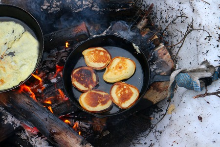 pyre: Maslenitsa (Pancake Week). Russian festival week before Lent. The festival is held outdoors, pancakes are baked on fire Stock Photo