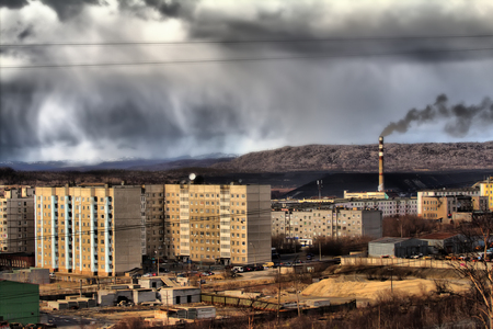 Bad ecology. Uncomfortable cities of polar region. High-rise buildings around the plant, dumps. Permanent rainy weather. HDR foto
