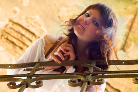 Beautiful woman on a stairs. girl looks down at you Stock Photo