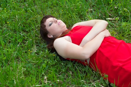 Girl in dress color of blood. Vampires victim (lethargy). Appearance and behavior ready and dark culture