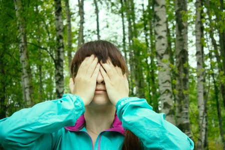 close your eyes: moments sports activities in wild nature Park. head massage, sports warm-up Stock Photo