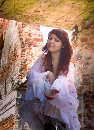 Girl in old-fashioned white dress among ruins of ancient manor 14 Let descendant of old aristocracy once taken away mercy