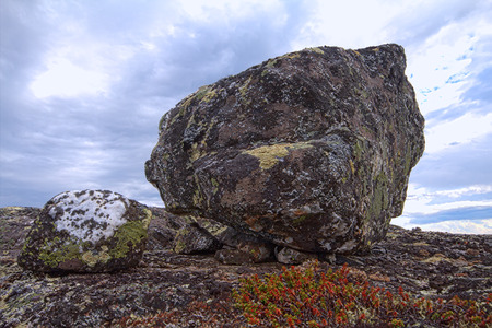 sectarian: Stone of a peculiar form, worshipped by  Saami.