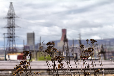 unfavorable: Bad ecology. Uncomfortable cities of polar region. High-rise buildings around the plant, dumps. Permanent rainy weather. HDR foto
