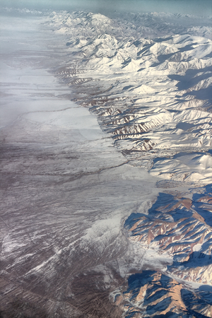 multitude: Flight over Pamir and Tien Shan 5. Visible deep mountain valley and multitude of parallel ridges.