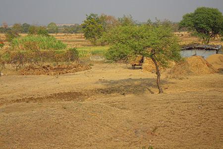 maharashtra: The area in district Nagpur, Maharashtra. India. Dry foothills with shrubs and peasant gardens. Stock Photo