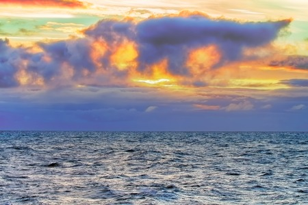 disturbing: Contrasting and changeable North sea. Disturbing sunset before storm