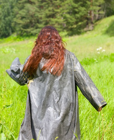 old ragged clothes. girl in a vintage coat chemical protection used in production