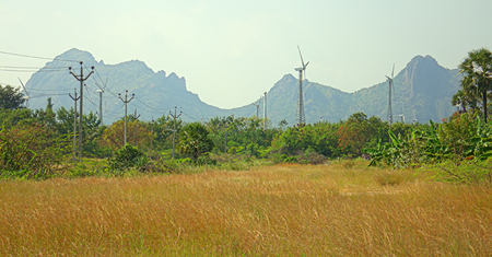 Alternative energy sources 8. Wind farm in Indian province of Kerala. Many wind-powered generators stand opposite to mountainous terrain
