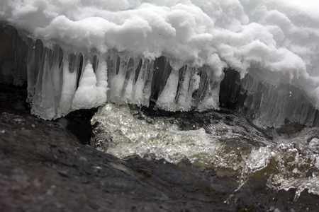 purl: Graceful icy fringe above water flow. Water purl and gurgling