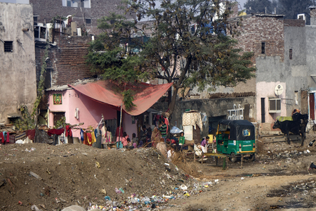 slums: India, Delhi - Dec 28, 2015: Indian slums and areas inhabited by poor, mix of villages and towns Editorial