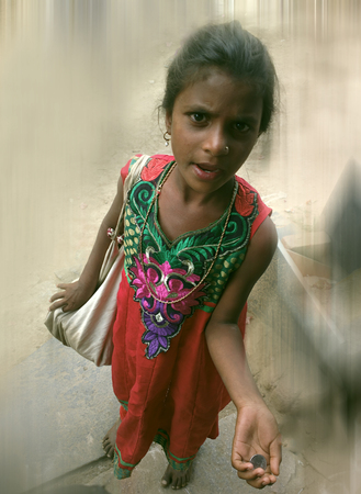 India, Anantapur - February 1, 2016: Beautiful mendicant. Slogan: Paragon doest spoil even hardship. Slender youth: necklaces, earrings, pin in nostril