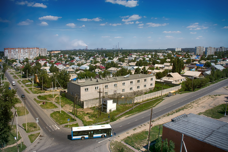 colonization: Kazakhstan, Pavlodar - July 24, 2016: City Pavlodar in Northern Kazakhstan 2016. Sector of private houses and apartment buildings quarter. Main area of development of virgin lands (steppe) in USSR in mid 20th century