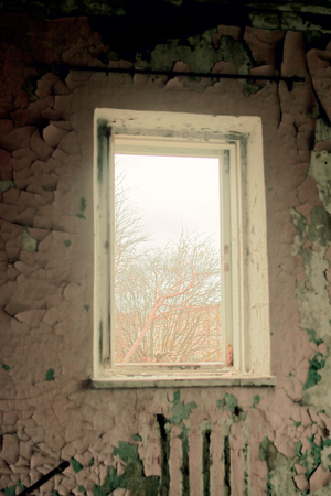 affliction: sad old abandoned dilapidated house. room stress and fear Stock Photo