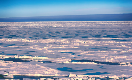 clime: Northern sea ice background winter bright. crack in ice pieces