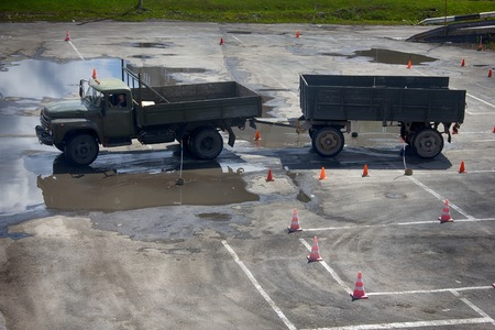 26: Russia, Tyumen - July 26, 2016: training of drivers driving a truck with a trailer. Academic circuit. Editorial