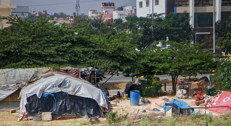 India, Thiruvananthapuram January 29, 2016: Substandard housing. Bidonville as evidence of property stratification of population and presence of extreme poverty. India. Asia