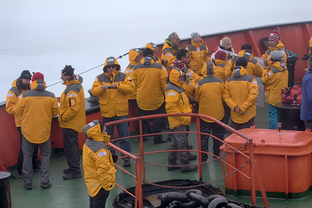 North pole - 15 July 2016: Joy tourists in reaching. Dancing on bow of atomic icebreaker Sajtókép