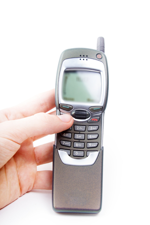 disposed: Old Mobile Phone. disposed obsolete phone on white background Stock Photo