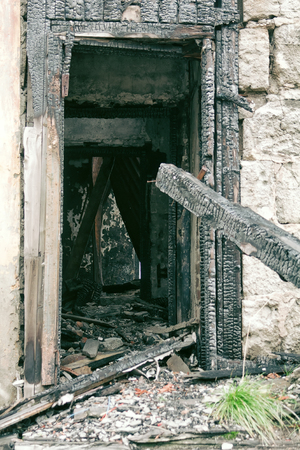 ruins of an abandoned houses. This old house had fire, charred door jamb