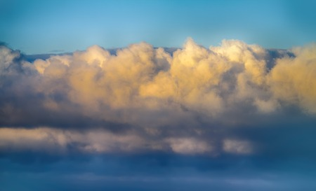 convective: Billowy clouds of weather front (front of cloud system) above coast, anabatic wind