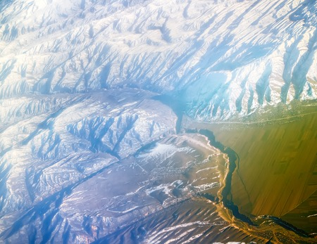 Flight over Pamir and Tien Shan 5. Visible deep mountain valley and multitude of parallel ridges. Stock Photo