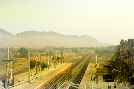 even: Ancient culture of India. Century-old trees are growing even on railway platforms. Karnataka Stock Photo
