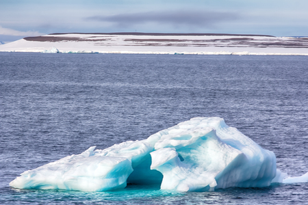 Icebergs, glaciers, growlers in Arctic ocean. Franz Joseph Land. British channel Stock Photo