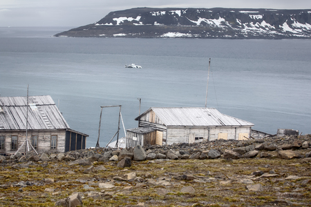 Severe land. One of the oldest polar stations in Arctic (founded in 1928, now abandoned). Wooden houses have been preserved well. Frantz Josef Land, island Hooker. Russian Arctic