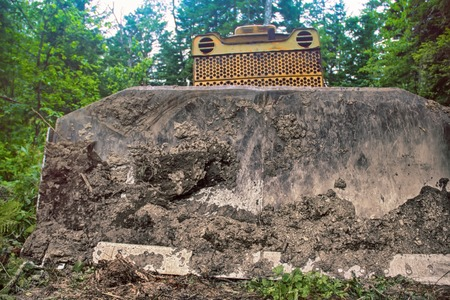 Destruction of forests for construction. Bulldozer clears site for construction of many kilometers pipeline in Northern coniferous forests. Visible forest and huge messy blade of powerful machines