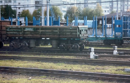 rail transportation of different goods. cars of train in summer Editorial