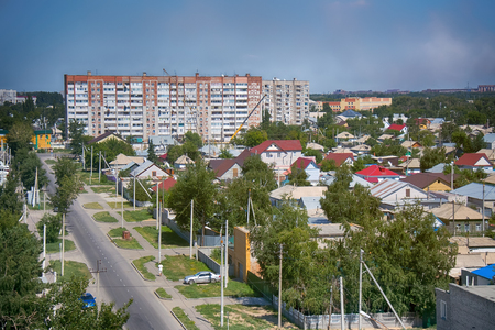Kazakhstan, Pavlodar - July 24, 2016: City Pavlodar in Northern Kazakhstan 2016. Sector of private houses and apartment buildings quarter. Main area of development of virgin lands (steppe) in USSR in mid 20th century