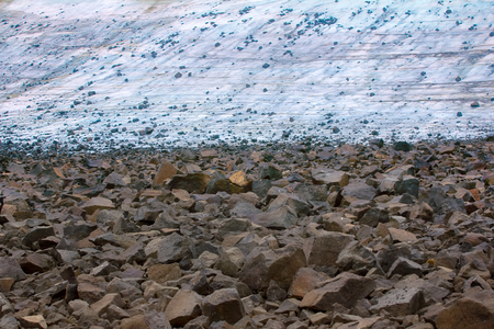 Melting of glaciers in high arctic zone. Currently, there are stones which are on glacier during the Ice age; glacial till, climate change, climatic variations, melting ice. Arctic, Franz Josef Land Фото со стока