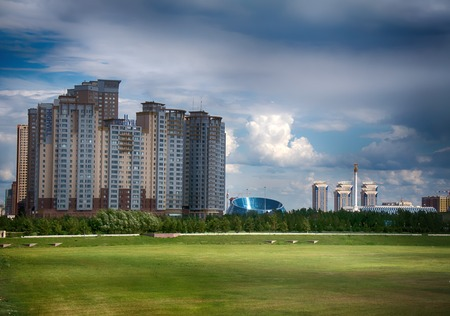 Astana, Kazakhstan - July 17, 2016: New capital of Kazakhstan city Astana. Modern architecture skyscrapers and element of Stalin's empire (eclectic, post-Soviet architecture)
