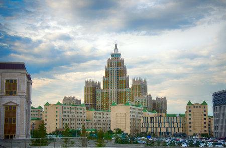 Astana, Kazakhstan - July 17, 2016: New capital of Kazakhstan city Astana. Modern architecture skyscrapers and element of Stalin's empire, Eastern neo-Moorish (eclectic, post-Soviet architecture)