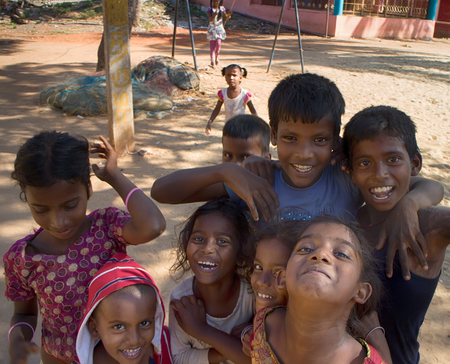 India, Puducherry - January 30, 2016: Daily life of India 13. Group of Indian kids different age jumps and plays in front of camera, group leader restores order Editorial