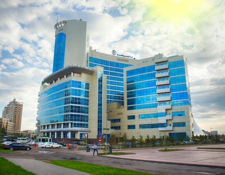 Astana, Kazakhstan - July 17, 2016: Walk around city with camera on button - exit to square with skyscrapers, lot of folks. New capital of Kazakhstan city Astana. Editorial