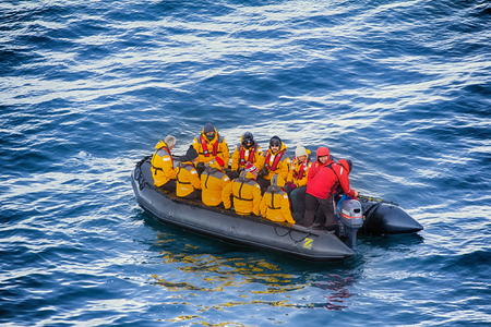 North pole - 2 July 2016: Tourists go on motor boat from ship to Islands of the Arctic ocean.