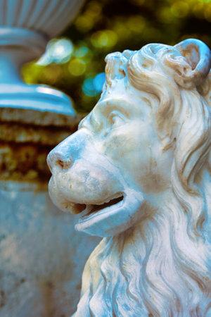 Russia, St. Petersburg - June 7, 2017: Architectural extravagances, aesthetic frills, decoration of buildings and streets. Sculpture, reliefs, symbols, chimeras, arabesque, emblem, coat of arms. Park sculpture, lion