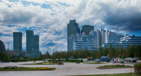 Astana, Kazakhstan - July 17, 2016: New capital of Kazakhstan city Astana. Modern architecture skyscrapers and element of Stalins empire (eclectic, post-Soviet architecture)