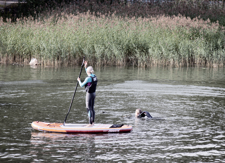 Helsinki , Finland - August 23, 2017: riding on sup boarding at summer weekend. urban water activities.
