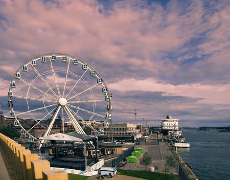 Helsinki , Finland - August 20, 2017: Promenade with boats and Ferris wheel. Baltc sea Editorial