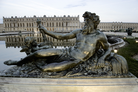 Versailles, France - September 26, 2017: park of Versailles in fall, Neptune and Cupid. Royal residence. Palace and Park ensemble era of Sun king, suburbs of Paris