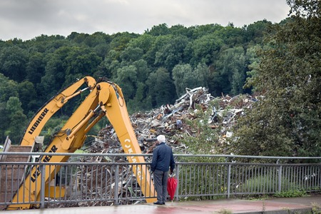 Near Stuttgart , Germany - September 12, 2017: Enterprise for collection and recycling of scrap metal (scrap-metal drive, recycling). Passer-by, casual observer is process of sorting waste and loading Editorial