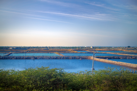 fish ponds dam is fenced off from big lake. industry of fish farming in Asia