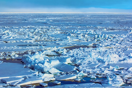 Ice reefing, hummocking. Toross and melt water pool in Arctic ocean at latitude 88 degrees, Ice near North pole in 2016.