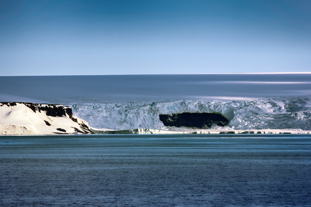 Islands along British channel. Glaciers, icefall, outlet glacier, snowfields, iceberg and rock outcrops. Franz Joseph Land