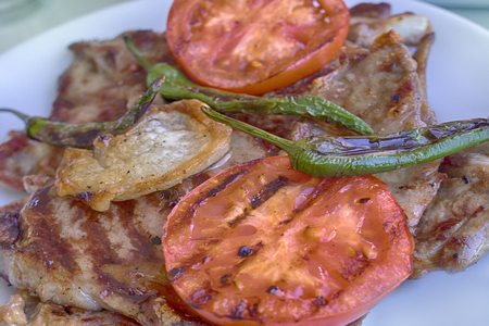 fried lamb with green peppers and tomatoes traditional Eastern food