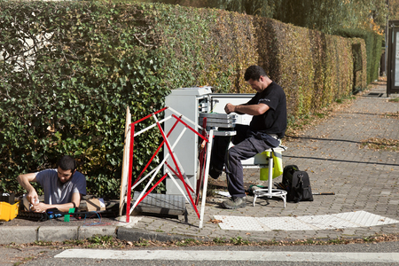 Strasbourg, France - September 18, 2017: Workers repairing bonding, communications, wireman, telephone worker, cable link Editorial